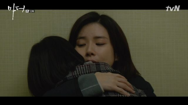 Soo-jin having a moment to rest with Hye-na in her arms